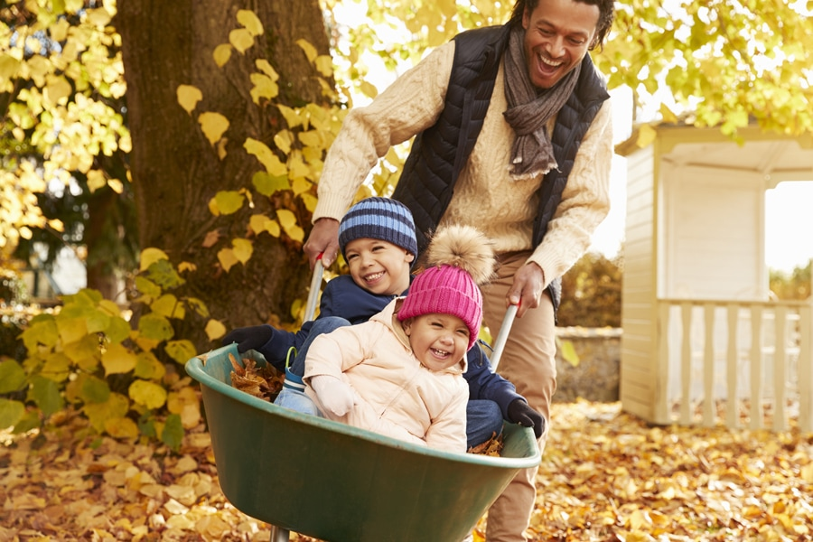 family enjoying fall after getting their fall furnace clean and check