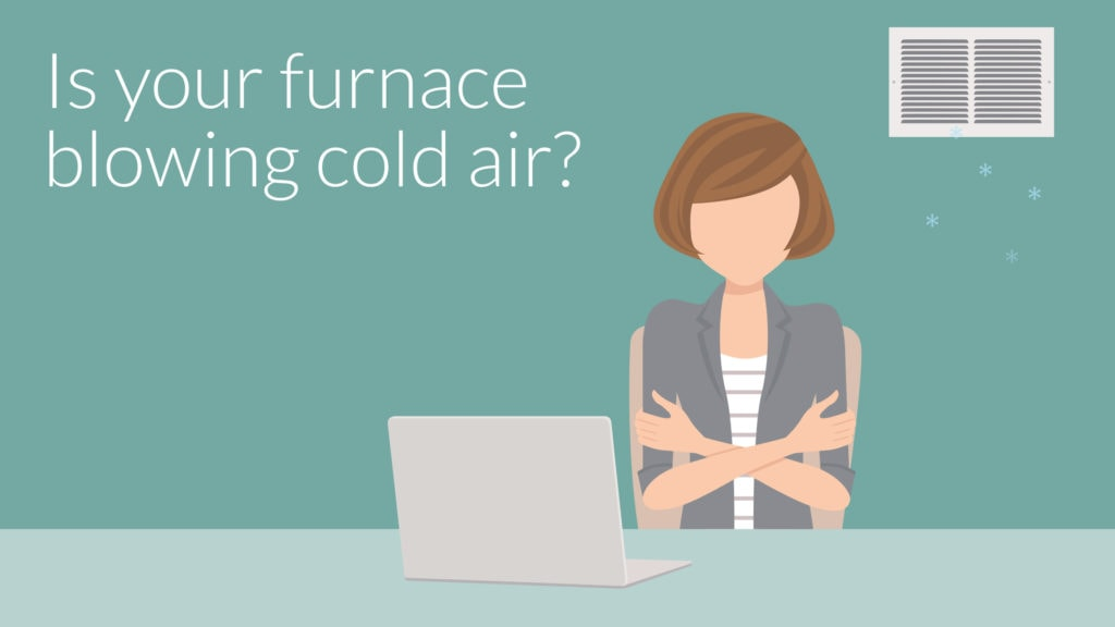 Woman shivering because her home's furnace is blowing cold air.